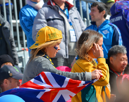 SOCHI, RUSSIA - March 16, 2014: Sport funs of Australia Team with national flags on Winter Paralympic Games  in Sochi. Giant Slalom, final day.