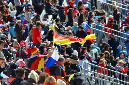 SOCHI, RUSSIA - March 16, 2014: Sport funs with national flags of Germany and Russia on Winter Paralympic Games in Sochi.