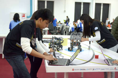 olympiad: SOCHI, RUSSIA - November 21, 2014: Philippines team at the robot Olympiad in Sochi . Here there was the World Robotic Olympiad 2014. It was attended by delegates from 47 countries.
