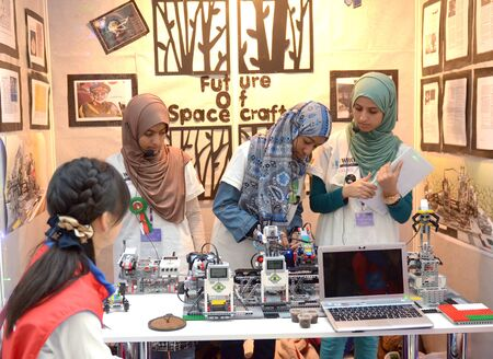 olympiad: SOCHI, RUSSIA - November 21, 2014: Musulman girls competes at the robot Olympiad in Sochi . Here there was the World Robotic Olympiad 2014. It was attended by delegates from 47 countries.