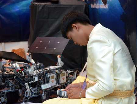malaisia: SOCHI, RUSSIA - November 21, 2014: Asian boy make a robot at the robot Olympiad in Sochi. Here there was the World Robotic Olympiad 2014. It was attended by delegates from 47 countries.