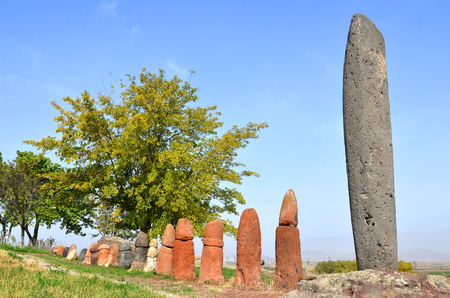 Stone phalluses (menhirs) in the ancient settlement of Metsamor, Armenia Stock Photo