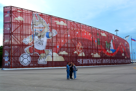 SOCHI, RUSSIA – June 16, 2017: People make selfie on the background of the symbols of the Confederations Cup in 2017 in Sochi Olympic Park