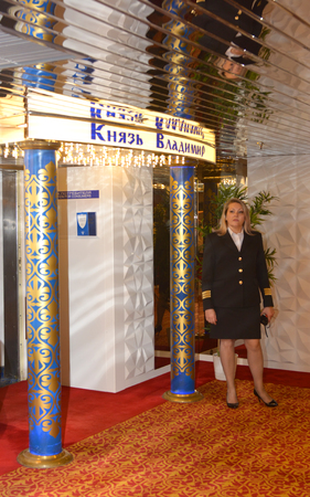 SOCHI, RUSSIA - June 11, 2017: Steward at the entrance to the restaurant of the cruise ship Prince Vladimir. The ship today set off for the first flight from Sochi.