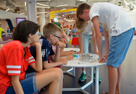 SOCHI, RUSSIA - June 24, 2017: Children are passionate about designing a robot in an open lesson of the All-Russian Educational Center