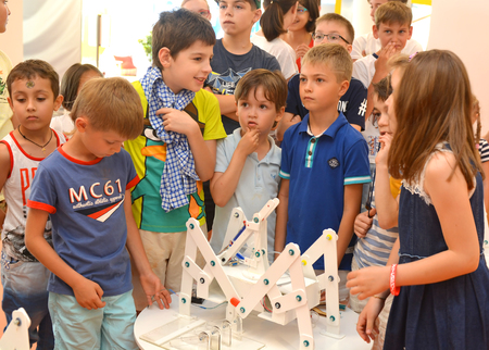 SOCHI, RUSSIA - June 24, 2017: The team of junior schoolchildren discusses the stage of designing a robot in an open lesson of the All-Russian Educational Center Sirius in Sochi