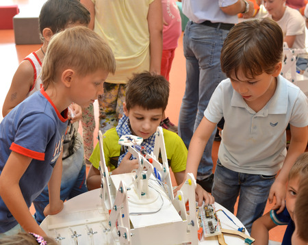 SOCHI, RUSSIA - June 24, 2017: The team of junior schoolchildren discusses the stage of designing a robot in an open lesson of the All-Russian Educational Center Sirius Editöryel