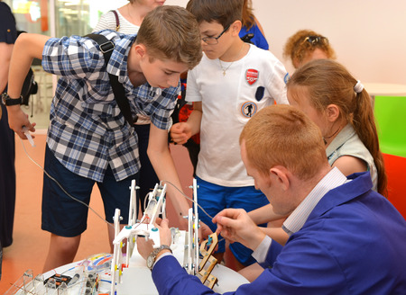 SOCHI, RUSSIA - June 24, 2017: Students with teacher program the robot in the open lesson, the All-Russian Educational Center