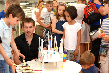 SOCHI, RUSSIA - June 24, 2017: Junior schoolchildren enthusiastically listen to the explanations of the teacher in robotics at an open lesson of the All-Russian Educational Center Sirius Editorial