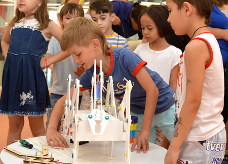 SOCHI, RUSSIA - June 24, 2017: Juniors make robots at an open lesson of the All-Russia Educational Center Sirius in Sochi