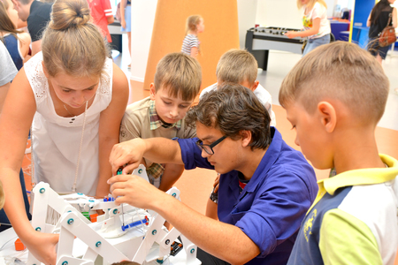 SOCHI, RUSSIA - June 24, 2017: Children's make robots whith a teacher at an open lesson of the All-Russia Educational Center