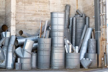 Air conditioning system ducting left overs stacked in a corner Stock Photo