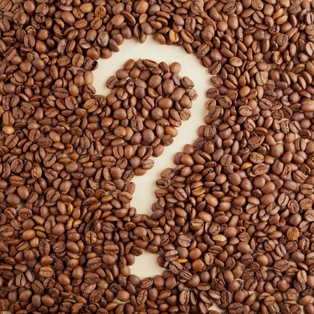A question-mark symbol made from coffee crops on hand-made paper Stock Photo