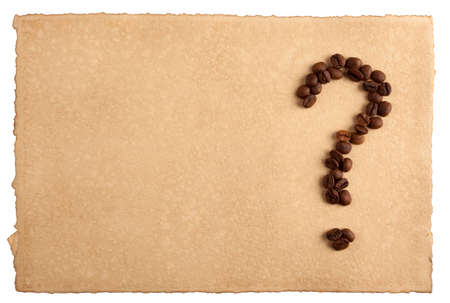 A question-mark symbol made from coffee crops on hand-made paper, isolated on white  Place for text