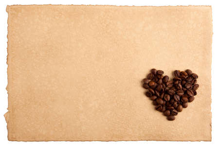 Heart symbol made from coffee crops on hand-made paper and isolated on white  Place for text Stock Photo - 12715584