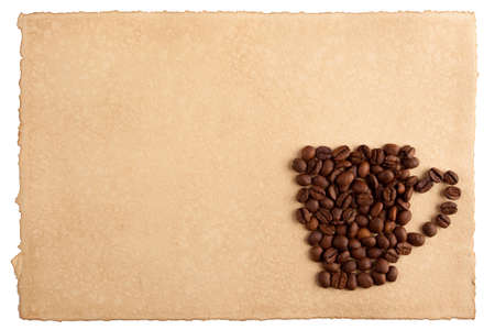 A mug symbol made from coffee crops on hand-made paper and isolated on white  Place for text  photo