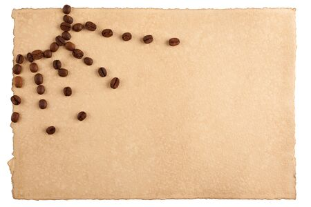 Childish sun symbol made from coffee crops on hand-made paper and isolated on white  Place for text