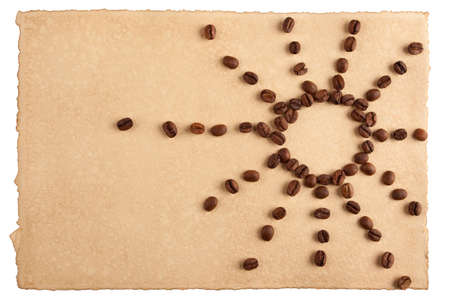 Childish sun symbol made from coffee crops on hand-made paper and isolated on white. Place for text. photo