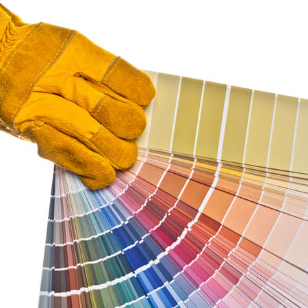 Worker s hand in a safety glove holding a color palette  Isolated on white Stock Photo - 12954566