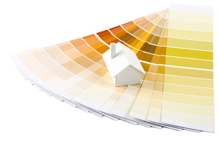 Small simple white model house on a color palette with different colors of yellow spectrum Stock Photo - 13446154