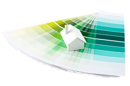 Small simple white model house on a color palette with different colors of green spectrum  Stock Photo - 13446153