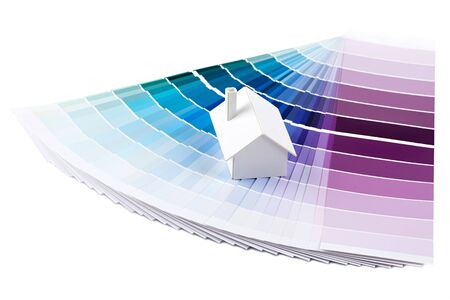 Small simple white model house on a color palette with different colors of blue spectrum Stock Photo - 13446155