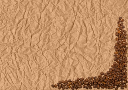 Crumpled brown paper and coffee beans, space for text  Stock Photo - 13446165