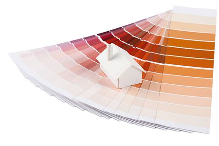 Small simple white model house on a color palette with different colors of red spectrum Stock Photo - 13992081