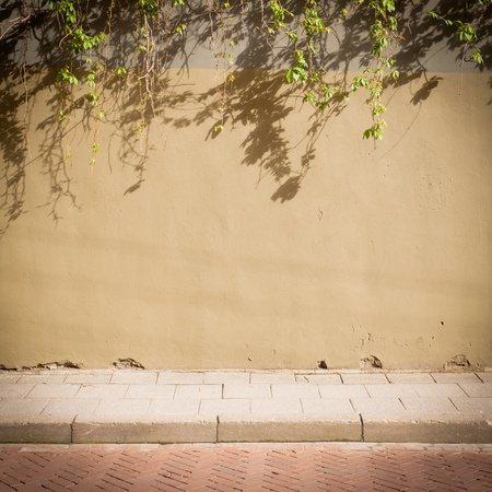 Urban grungy street wall, may be used as background or texture photo
