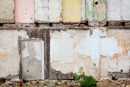 abandoned house: Grungy wall of an abandoned house