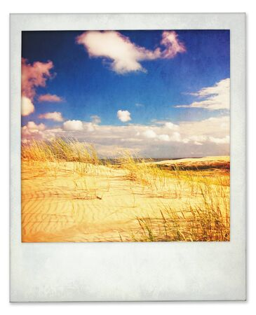 Aged and a little dirty instant photo of dunes and sky with light leaks photo