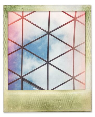 Instant photo of glass roof structure with sky and clouds, isolated