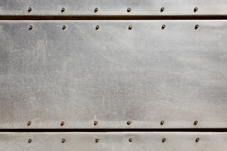 rivet metal: Old grungy, dirty and scratched metal plate with screws Stock Photo