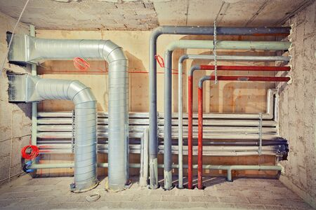 Pipe system of air-conditioning, water and gas shot in a new built unfinished building. photo