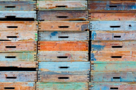Stack of old wooden drawers painted in different colors photo