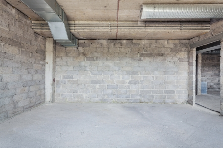 Unfinished building interior, empty room with conditioning canals