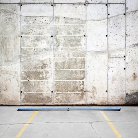 Urban grungy parking wall, may be used as background or texture Stock Photo