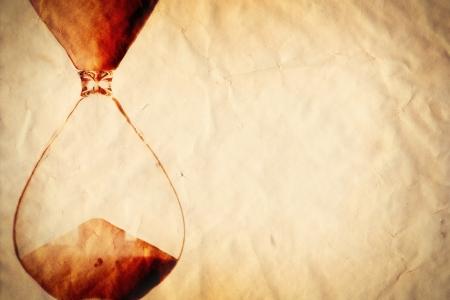 time frame: Time concept, vintage sand clock on paper background