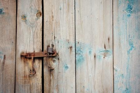 Old wooden door with rusty lock photo