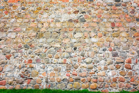 Old stone wall of a medieval castle. Standard-Bild