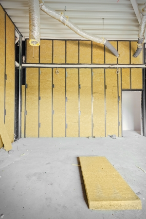 Unfinished building inter, room walls covered with rock wool Stock Photo - 25289051
