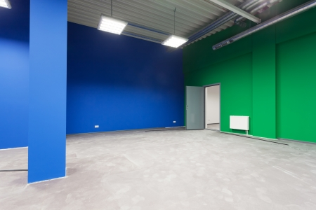 Unfinished building interior, blue and green hall. Stock Photo