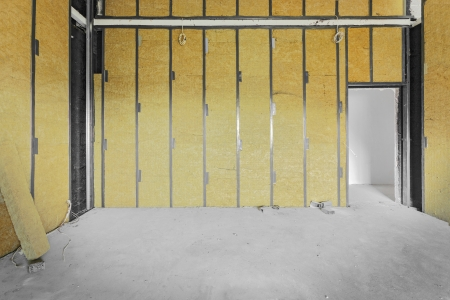 Unfinished building interior, walls covered with rock-wool. Stock Photo - 25289125