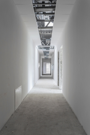 Unfinished building interior, white unpainted hallway Stok Fotoğraf