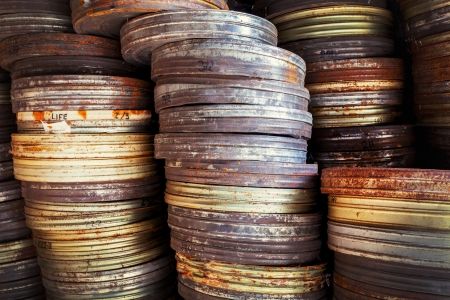 Old movie film canisters, abandoned  and rusty Stock Photo