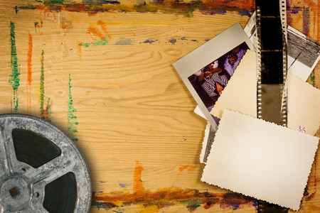 Vintage photo stack on wooden background with copy space photo