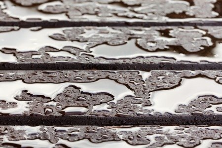 Wet wooden floor during rain, abstract background, shallow depth of field photo