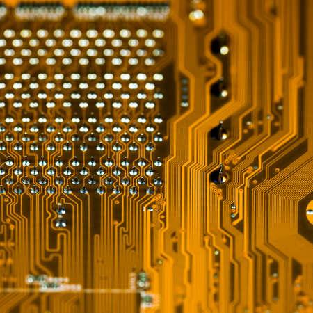 Orange circuit board background, macro shot. shallow depth of field photo