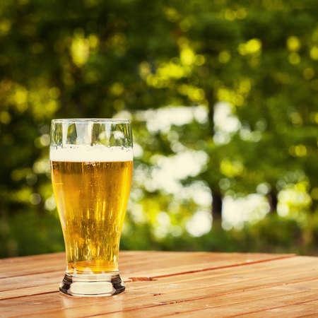 single beer: Glass of beer in nature