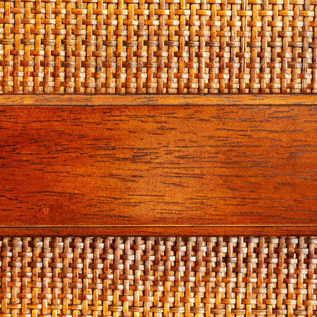 Wooden bamboo mesh texture with a plank of wood for copyspace design detail Stock Photo
